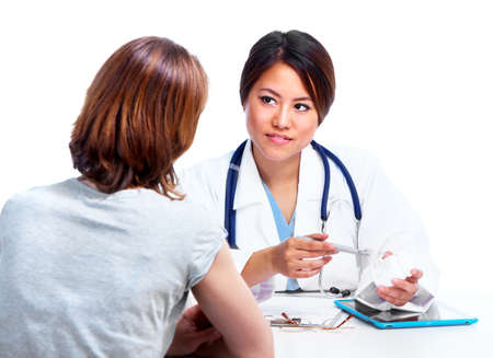 Chinese medical doctor woman with patient