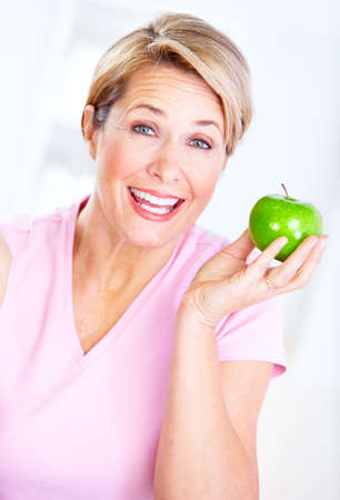 Senior woman with apple  Diet  photo
