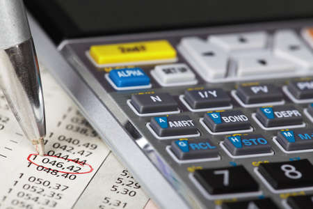 Calculator and a financial document  photo