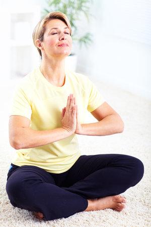 chi: Senior woman doing yoga  Stock Photo