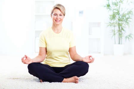 Senior woman doing yoga  photo