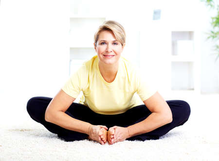 tai chi: Senior woman doing yoga  Stock Photo