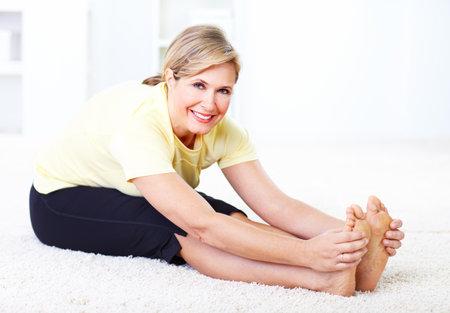senior yoga: Senior woman doing yoga  Stock Photo