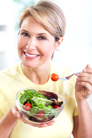 Senior woman with a salad  Diet  photo