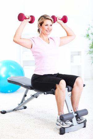middleaged: Senior woman doing yoga  Stock Photo