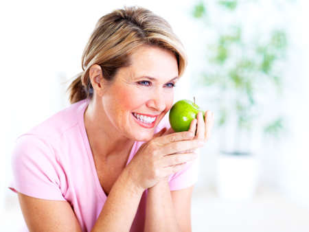 senior eating: Senior woman with apple  Diet