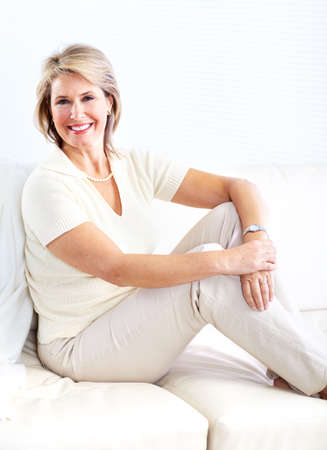 couches: Senior woman relaxing at home  Stock Photo