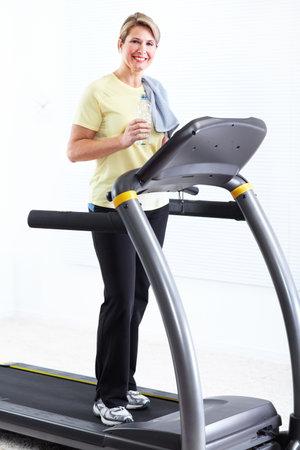 middleaged: Senior woman doing exercise  Stock Photo