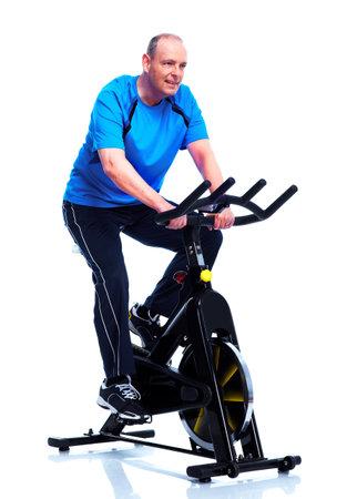 exercitation: Fitness man on bike. Isolated on white background.