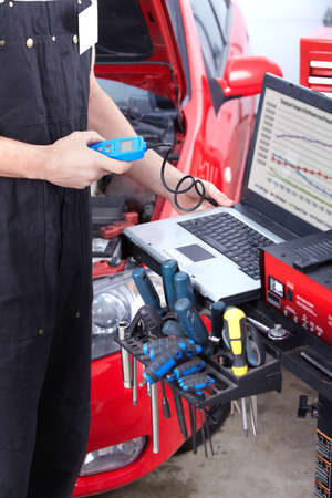 auto repair: Professional mechanic working in auto repair service..