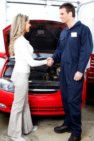 Auto mechanic and a client woman  photo