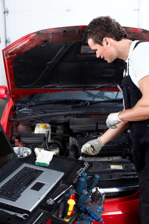 Auto mechanic checking oil  photo