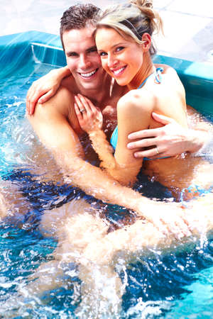 Young couple in jacuzzi  photo