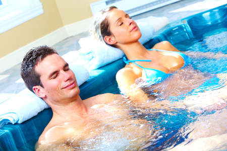 Young couple in jacuzzi Stock Photo - 14650231