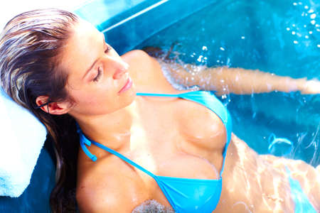 jacuzzi: Young woman in jacuzzi  Stock Photo