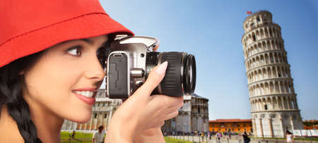 Tourist woman with a camera  photo