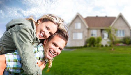 real estate investment: Happy family near new house