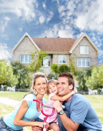 home loans: Happy family near new house