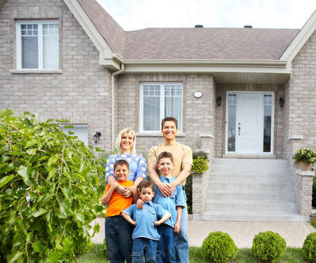 home insurance: Happy family near new house