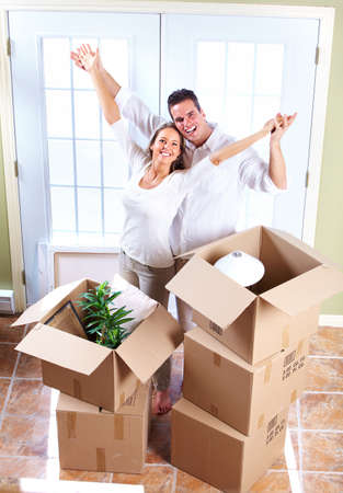 buying a house: Happy couple moving in a new house  Stock Photo