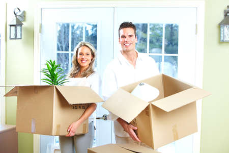 moving box: Happy couple moving in a new house  Stock Photo