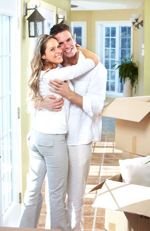 Happy couple moving in a new house  photo
