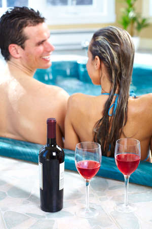 Young couple in hot tab photo