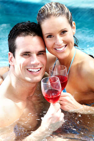 Young couple in hot tub photo
