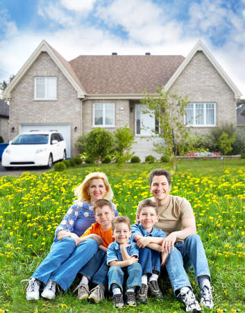 home insurance: Happy family near new house