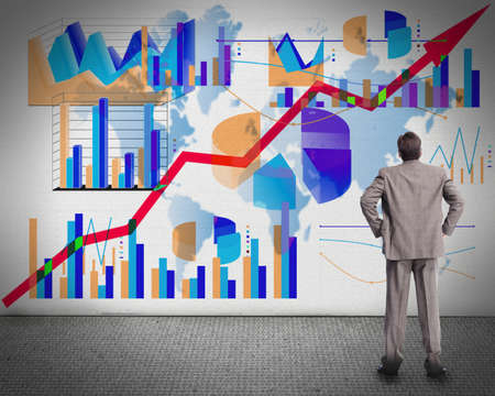 economy growth: Businessman looking at graphs