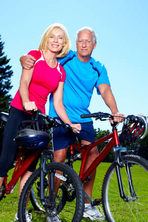 Senior couple with bicycle  photo