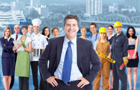 professions: Businessman and Group of industrial workers  Stock Photo