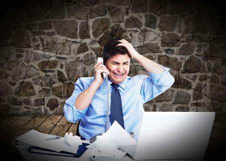 Businessman having a stress  photo