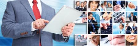 Businessman with an ipad computer  photo