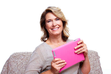 Senior woman with a tablet computer Stock Photo - 15412603