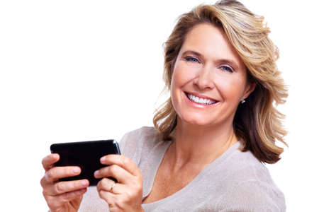 Happy senior woman with a smartphone  photo