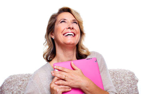 Senior woman with a tablet computer  Stock Photo - 15412602