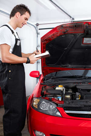 Car mechanic in auto repair service   photo