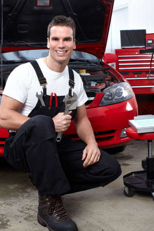 auto mechanic: Auto mechanic with a wrench