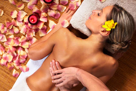 spa therapy: Young woman in Spa massage salon  Stock Photo