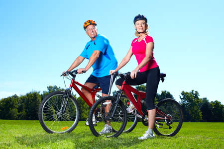 Senior couple with bicycle  photo