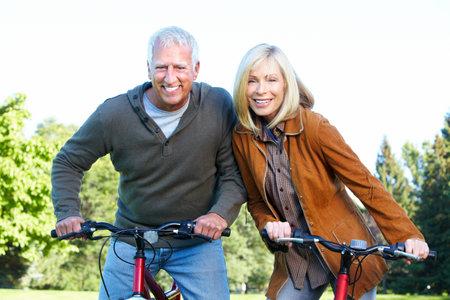 Happy senior couple cyclist  스톡 콘텐츠