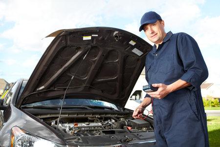 broken car: Professional auto mechanic