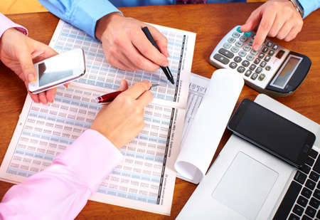 financial services: Hands of accountant business woman