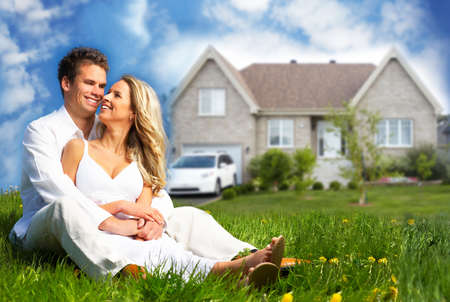 residential home: Happy family near new house