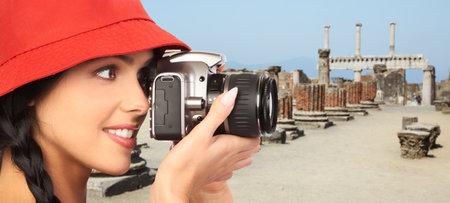Tourist woman with a camera  photo