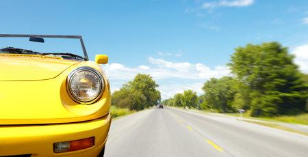 yellow car: Retro car on the road