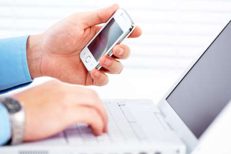 mobile communication: Hands of people working in the office. Technology.