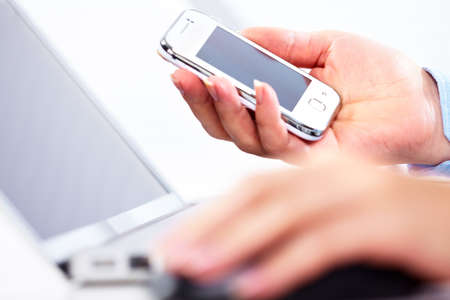 phone business: Hands of people working in the office. Technology.
