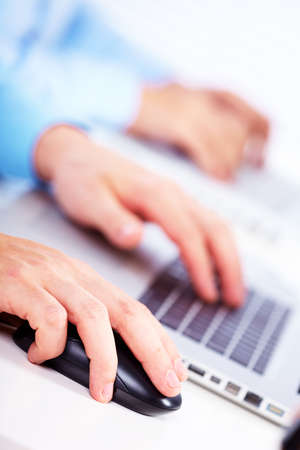 Hand with a computer mouse. Business technology background. Stock Photo - 15433285